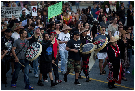 Protesters march during a rally held to show opposition to the Enbridge Northern Gateway pipeline in Vancouver, B.C., on Tuesday June 17, 2014. The federal government is giving a conditional green light to Enbridge Inc.'s controversial $7-billion Northern Gateway pipeline project between the Alberta oilsands and the B.C. coast. Photograph by: Darryl Dyck , CP